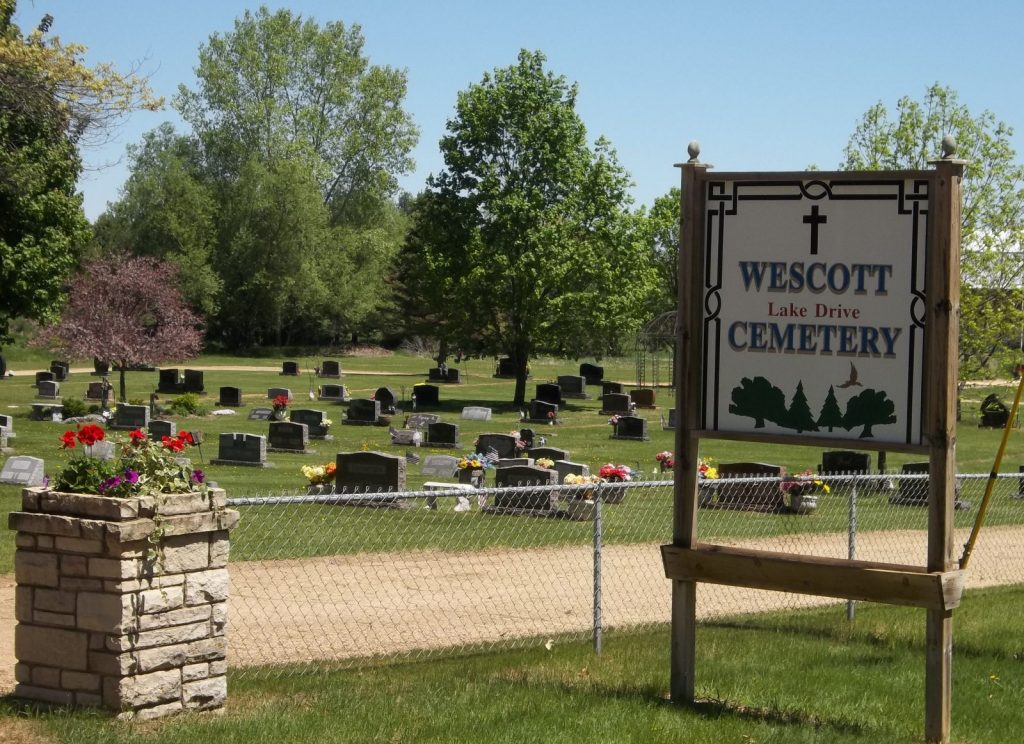 cemetery-sign-and-flowers